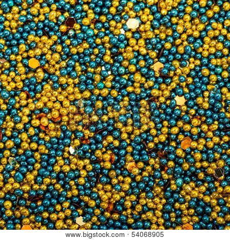Background From Turquoise And Golden Balls Of Bead