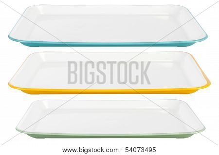 Colored Plastic Platters On White Background