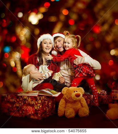 Christmas Family Of Four Persons Happy Smiling Over Red Background