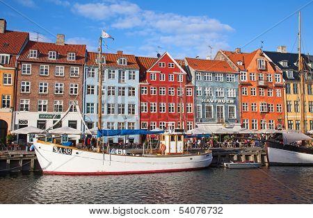COPENHAGEN, DENMARK - AUGUST 25: unidentified people in open cafes of the famous Nyhavn promenade on August 25, 2010 in Copenhagen, Denmark. Nyhavn is one of the most famous landmark of Copenhagen.