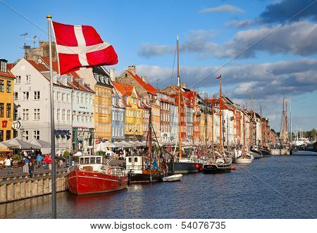 COPENHAGEN, DENMARK - AUGUST 25: unidentified people in open cafes of the famous Nyhavn promenade on August 25, 2010 in Copenhagen, Denmark. Nyhavn is one of the most famous landmark of Copenhagen.