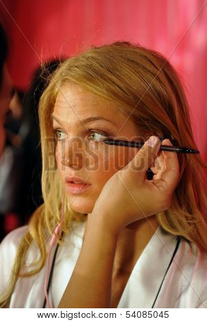 NEW YORK NY - NOVEMBER 13: Model Erin Heatherton prepares backstage