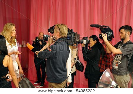 NEW YORK NY - NOVEMBER 13: Model Toni Garrn giving away interviews backstage