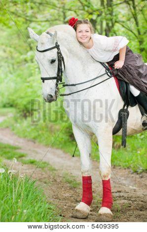 Beautiful Girl Riding White Horse
