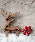 Wooden christmas deer on fabric  background