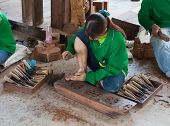 Woman Hands Carving A Wooden Sculpture For The Sanctuary Of Truth. Pattaya