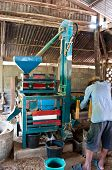 pic of chafing  - Milling rice at Roi Et Province in Thailand - JPG