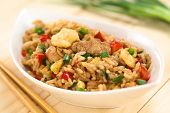 pic of chopsticks  - Homemade Chinese fried rice with vegetables chicken and fried eggs served in bowl with chopsticks on the side  - JPG