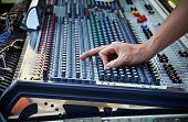 stock photo of mixer  - Sound engineer works with sound mixer hands close - JPG