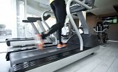 stock photo of treadmill  - Woman running on treadmill - JPG
