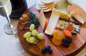 stock photo of fruit platter  - Overhead view of a cheese and fruit platter with sparkling wine - JPG