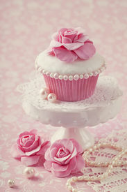 foto of sugarpaste  - Cupcake with rose flower on a stand - JPG