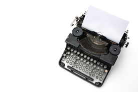 foto of outdated  - Vintage typewriter with paper sheet isolated on white - JPG