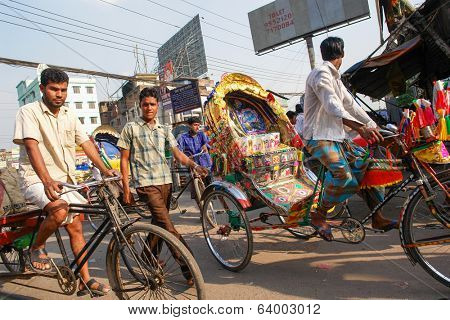 DHAKA, BANGLADESH - MARCH 25, 2009: Traditionally ornamented cycle rickshaws presents a very practical commute during rush hours of Dhaka traffic.