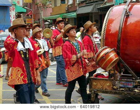 Young Men Play Percussion Instruments