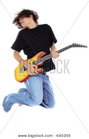 Boy Jumping With Electric Guitar Over White