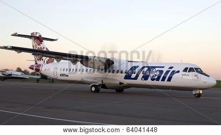 Utair-Ukraine Airlines ATR-72 aircraft runnig on the runway