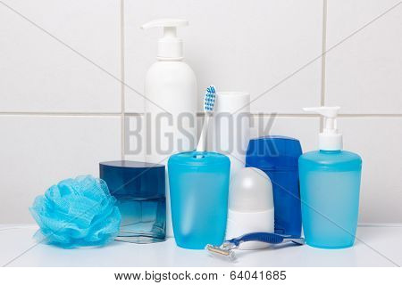 Male Hygiene Supplies Over White Tiled Wall In Bathroom