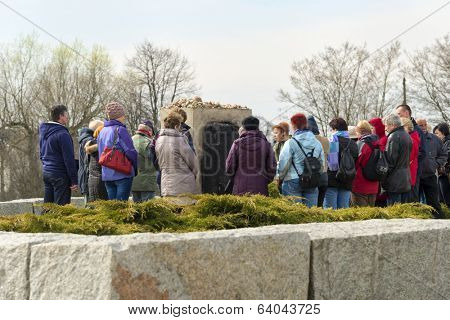 JEDWABNE - APRIL 6: Peoples at the monument of Jewish massacre in Jedwabne, Poland on April 6, 2014. Monument is a place for memory extermination of the Jews in Jedwabne, this happened in July 1941.