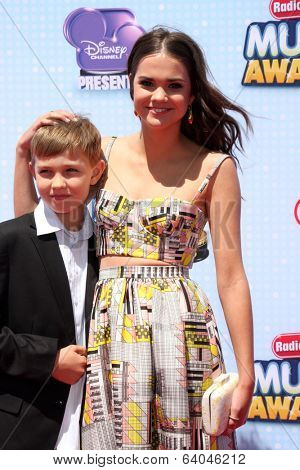 LOS ANGELES - APR 26:  Maia Mitchell, brother at the 2014 Radio Disney Music Awards at Nokia Theater on April 26, 2014 in Los Angeles, CA