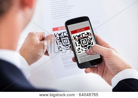 Businessman Scanning A Barcode