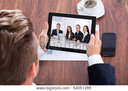 Portrait Of A Businessman Looking At Digital Tablet