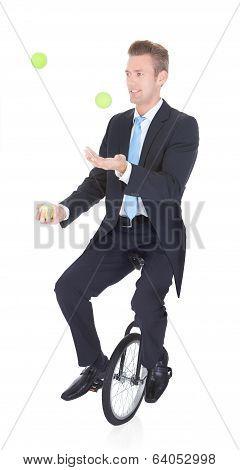 Happy Businessman Juggling