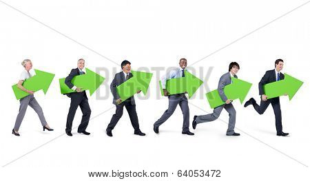 Mullti-ethnic group of people walking and holding green arrows