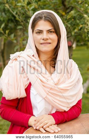 Beautiful Middle Eastern Woman In Pink Scarf