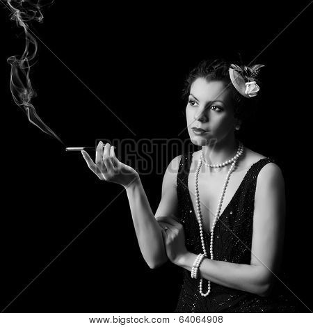 Vintage 1920s lady smoking a cigarette with a mouthpiece