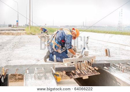 Workers on bridge construction
