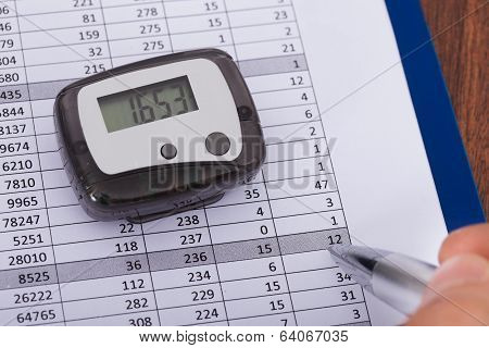 Hand Over Sheet With Digital Pedometer
