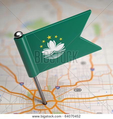 Macau Small Flag on a Map Background.