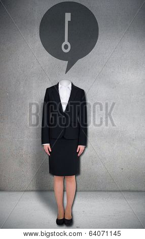 Composite image of headless businesswoman with key in speech bubble in grey room