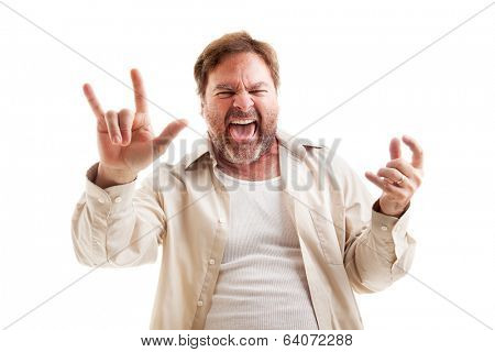 Middle-aged man rocks out playing air guitar and making the rock-n-roll symbol.  Isolated on white.
