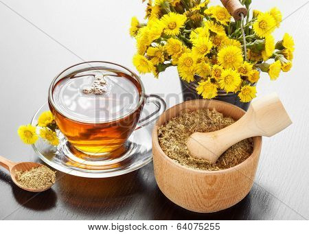 Healthy Tea, Bucket With Coltsfoot Flowers And Mortar On Table
