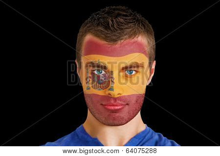 Composite image of serious young spain fan with facepaint against black