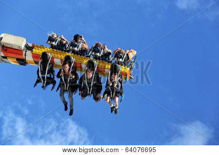 Hanging in the air on a funfair ride