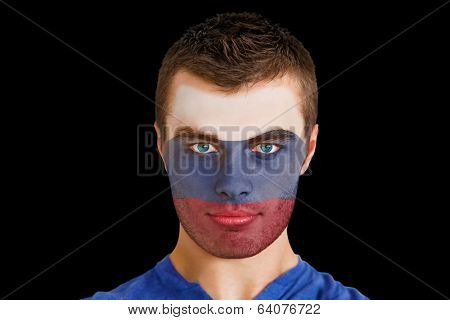 Composite image of serious young russia fan with facepaint against black
