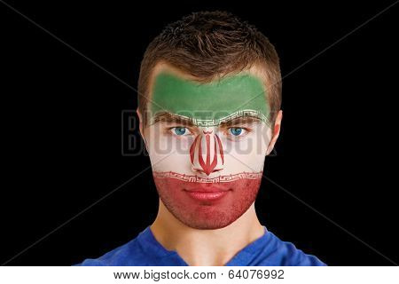 Composite image of serious young iran fan with facepaint against black