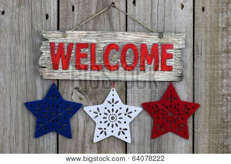 Red welcome sign with red, white and blue stars