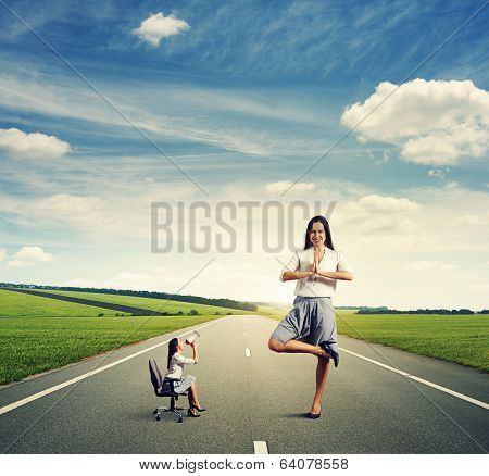 businesswoman screaming at big calm woman on the road
