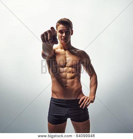 Muscular Man In Underwear Pointing Forward