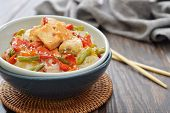 stock photo of rice noodles  - Rice noodles with chicken and vegetables in bowl closeup - JPG