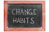 stock photo of  habits  - change habits phrase handwritten on isolated vintage blackboard - JPG