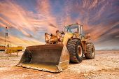 stock photo of bulldozer  - bulldozer on a building site - JPG
