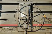 picture of railroad car  - An operating wheel on a railroad freight car disengages the lock so that side door may be opened - JPG