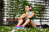 picture of spring break  - Relaxed fitness woman on a workout rest drinking detox smoothie on spring or summer - JPG