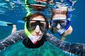 image of female mask  - Underwater photo of a young couple snorkeling at tropical ocean  - JPG