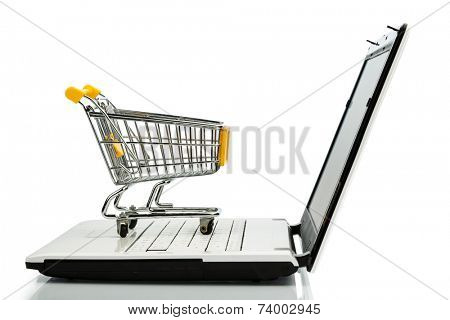 shopping cart is on the keyboard of a laptop, symbol photo for online shopping and consumer behavior